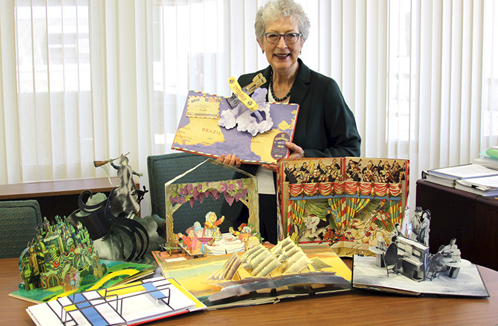 Glenda Thornton with with some of the pop-up books in her collection