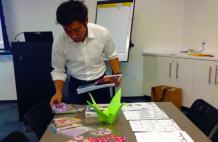Haruhide Osugi of the Japan Outreach Initiative demonstrates origami